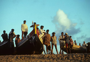 Fishermen and boats on beach, Puri, Orissa, India